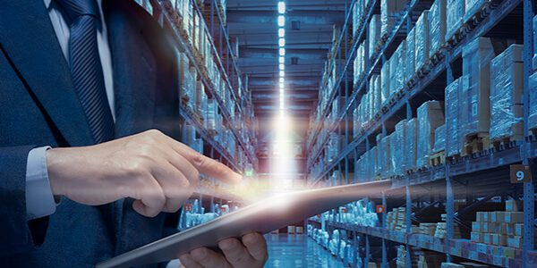 business-man-manage-warehouse-by-internet-technology-show-modern-warehouse-distribute-network-business-concept-businessman-use-tablet-plan-check-control-logistics-transportation-warehouse (1)